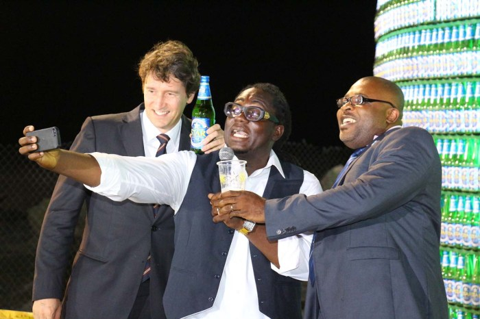 Marketing Director NB PLC Walter Drenth, Comedian Lafup, Corporate Affairs Adviser NB PLC Kufre Ekanem take a selfie at the Unveiling of the Star Bottle Tree
