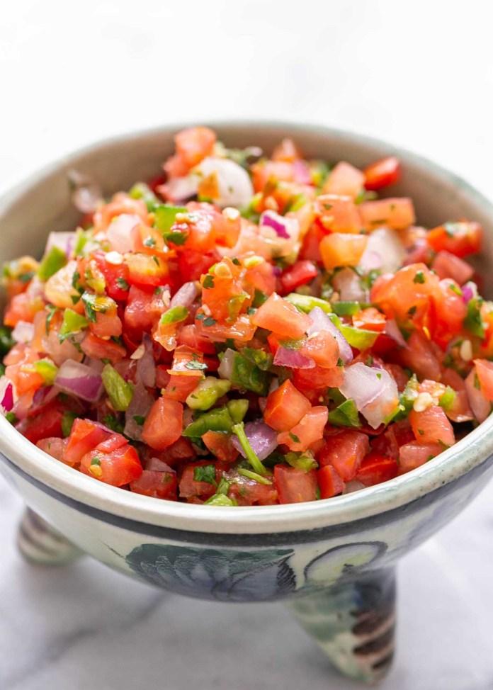 fresh tomato salsa close up on chopped tomatoes