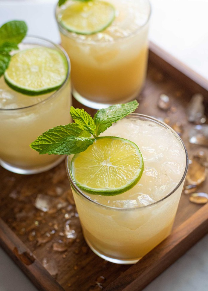 Mai Tai Cocktail - peach drink with ice and lime