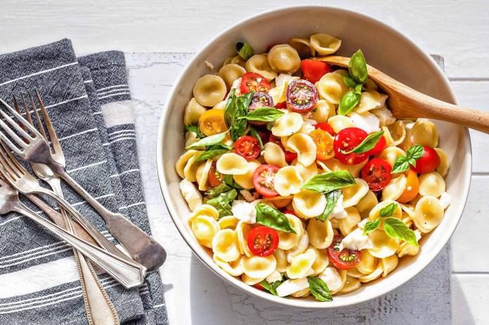 How to Make Caprese Pasta Salad - bowl of caprese salad with pasta