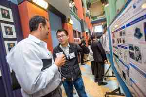 Scientific poster discussion at Rice University Anne & Charles Duncan Hall