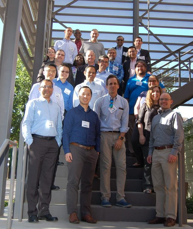 Industry Partners on stairs from annual meeting event