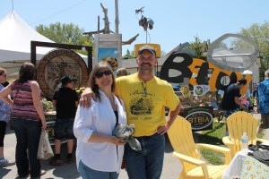 Bo Niederhuber, president of the Beeton–Tottenham Business Improvement Association (BTBIA) and his wife Sharon, in front of the amazing entries for the 'Great Big Beeton Bee Part III' contest at the Beeton Honey & Garden Festival last Saturday.