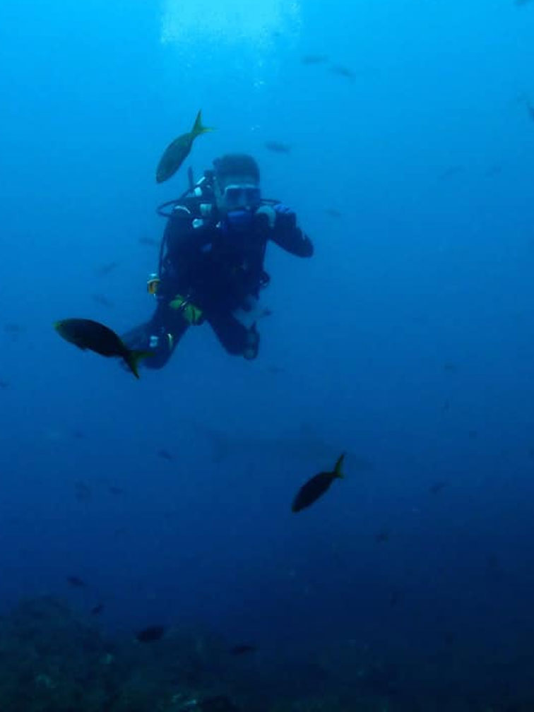 Dr. Koganski scuba diving underwater