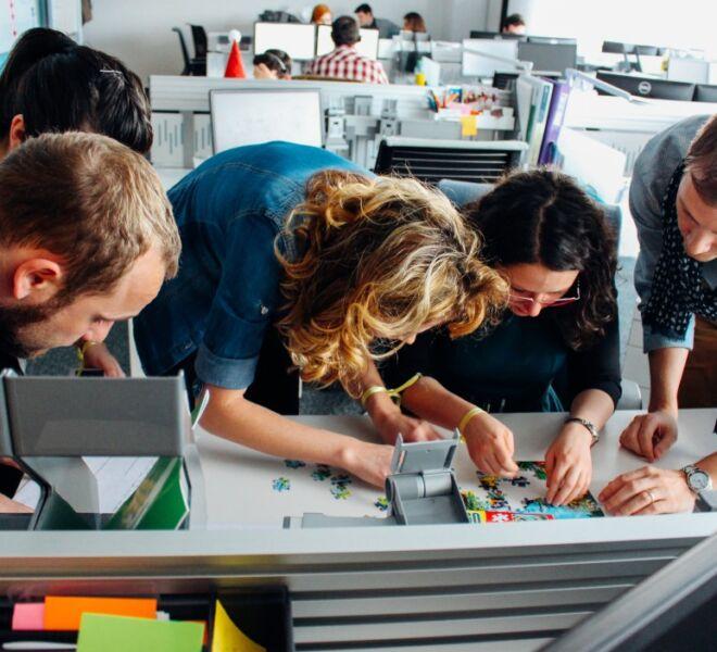 colleagues-solving-a-puzzle-at-work-teamwork-challenge_t20_plpYak