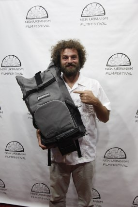 Winner Travis Knight shows off his prize Betabrand Storrist Bag