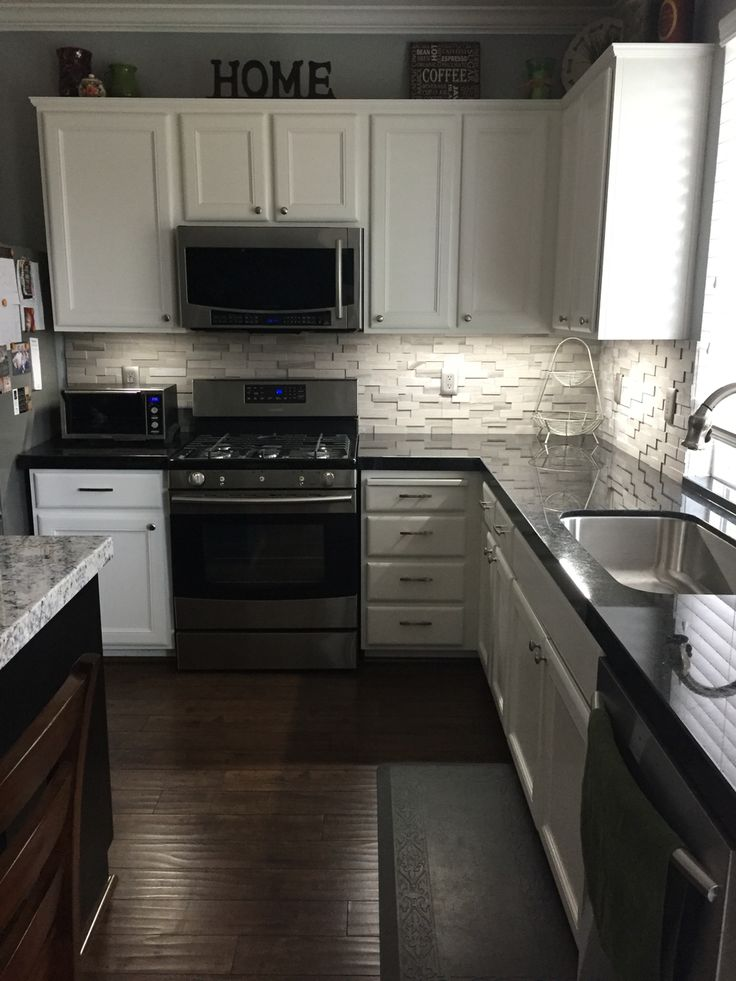 granite kitchen glass inserts for cabinets black countertops discount prices new view looking