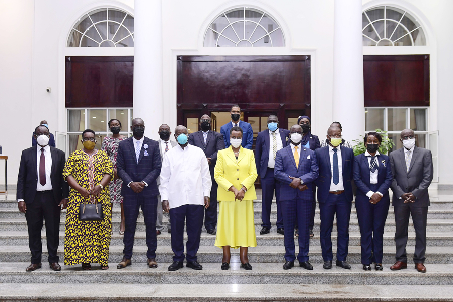 President Museveni and First Lady Janet Museveni take a group photo with Onyango (third from left) and other officials