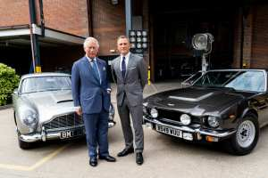 Daniel Craig giving Prince Charles a tour of the Aston Martin DB5 and V8 Vantage at Pinewood Studios for the upcoming Bond 25