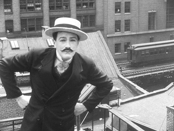 Edgar Barrier as M. Dathis on a rooftop, what is now the Highline in the background.