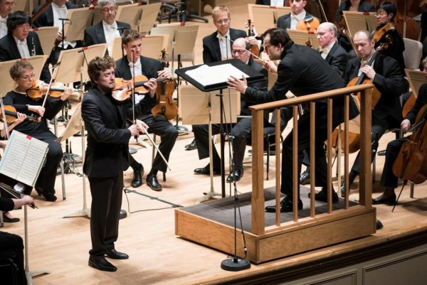 Christian Tetzlaff with the BSO and Andris Nelsons. Photo Liza Voll.