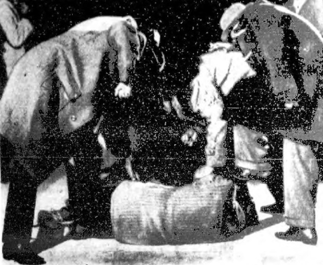 This remarkable picture was taken by a newspaper in 1958 where members of a South Jamaican gang created a stomping scene. This picture was posed, but they showed what it would be like for several gang members to stomp kick a hapless enemy gang member who had the misfortune of being caught. The gang that posed this picture demanded that their faces wouldn't be shown in the picture.