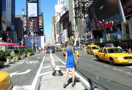 times square hailing cab