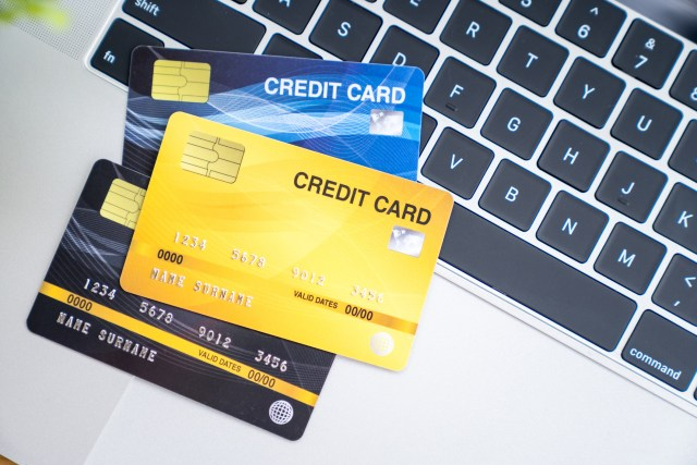 Many credit card on computer laptop, Online shopping concept