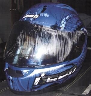 motorcycle helmet with visor scraped