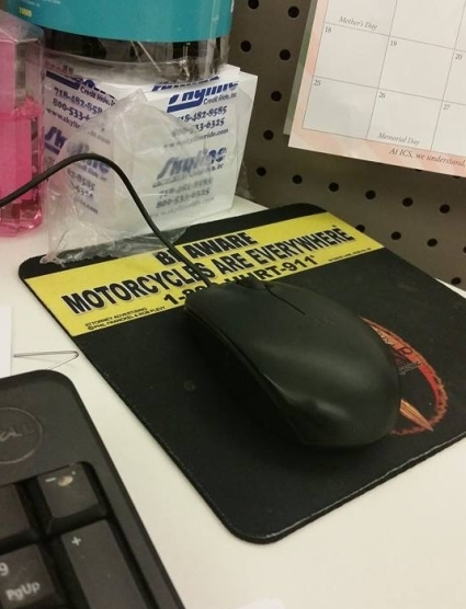 BE AWARE MOTORCYCLES ARE EVERYWHERE® mouse pad on office desk