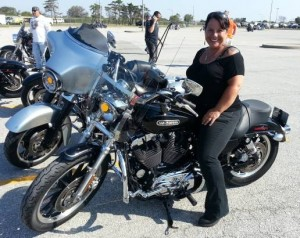Photo of friend Donna sitting on her Harley Davidson motorcycle
