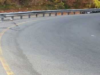 guardrail on curve of highway ramp