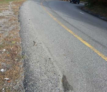 Sand and gravel alleged to have caused the motorcycle accident