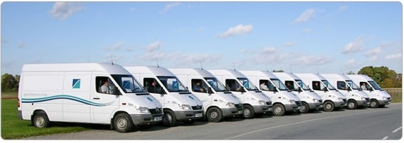 This image is a fleet of commercial vehicles