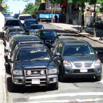 Is double parking legal for passenger vehicles in NYC