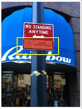 This image is a legal no standing sign with a yellow box highlighting the orange addendum