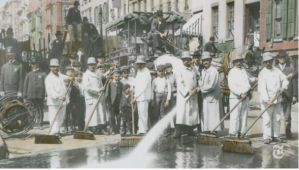 This image is a vintage image of NYC sanitation solders cleaning the streets