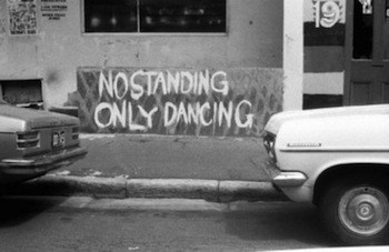 This image is graffiti on a wall saying, no standing only dancing