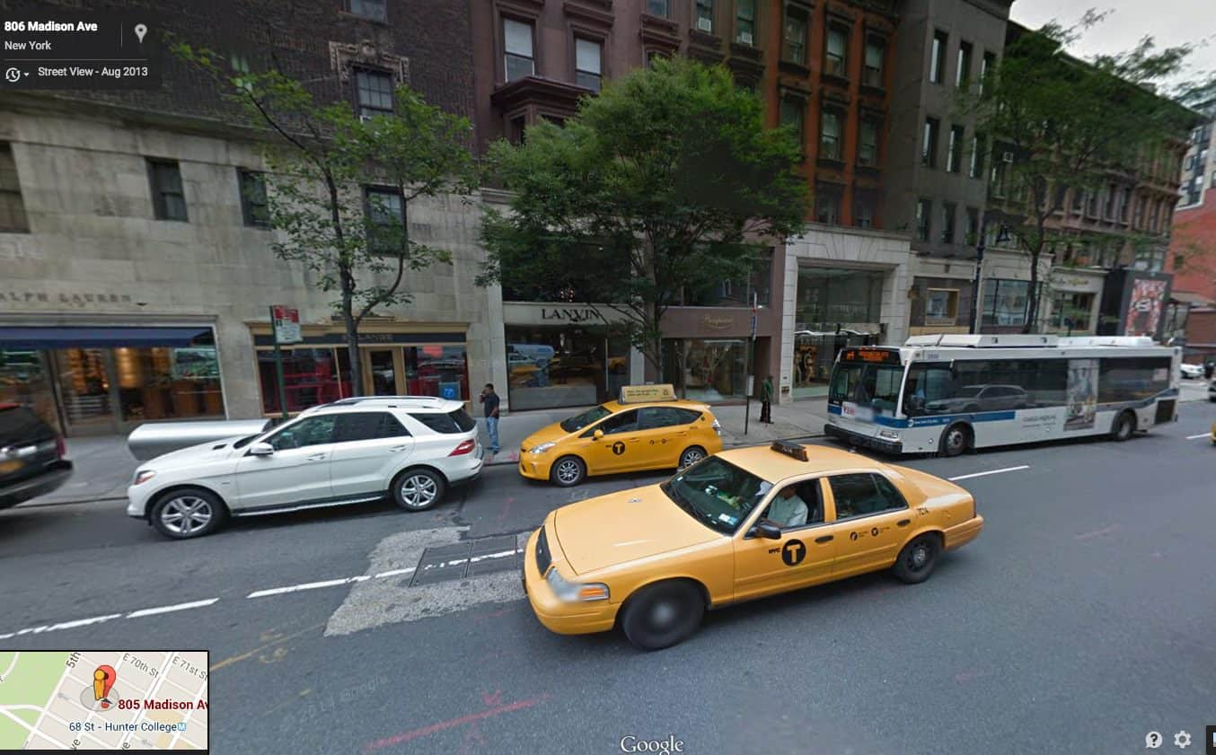 Showing a bus standing in a bus stop zone on Madison Avenue