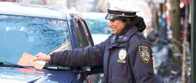 Traffic Enforcement Officer issuing NYC parking ticket