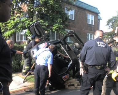 This car rolled over on its side when it was hit by a car that ran a stop sign in The Bronx, NYC. The car accident caused a knee injury to the passenger and soft tissue injury to the driver.
