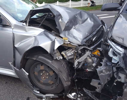 Image showing two cars that crashed in a head-on collision