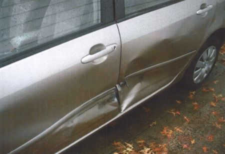 sideswipe damage to car from accident
