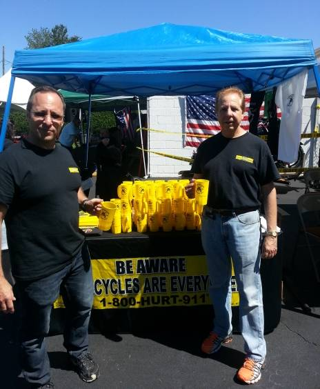 The Best Motorcycle Accident Lawyers in New York, Rob Plevy and Phil Franckel at the 1-800-HURT-911 tent at the Forsaken Guns LEMC BBQ