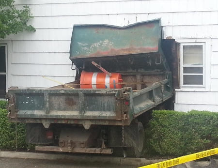 Truck accident with house