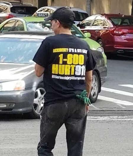 Man wearing 1-800-HURT-911 Bronx accident lawyer tshirt