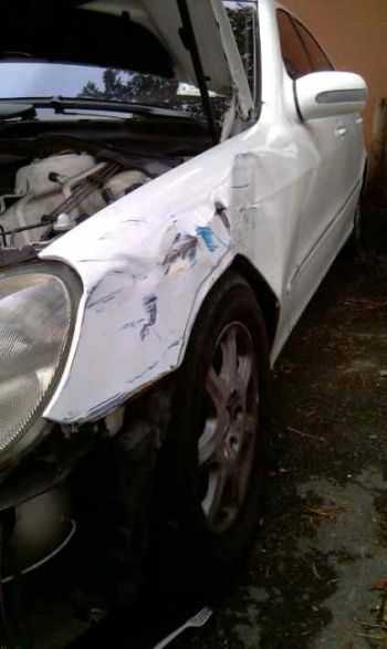 accident damage to driver's side fender on car hit when parked