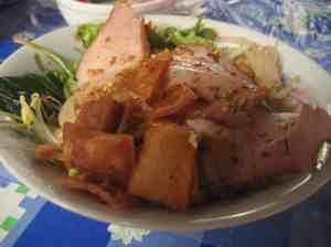 Cau Lao - a Vietnamese noodle dish with crispy wontons and pork