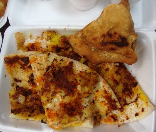 chili & onion uttapam with a samosa