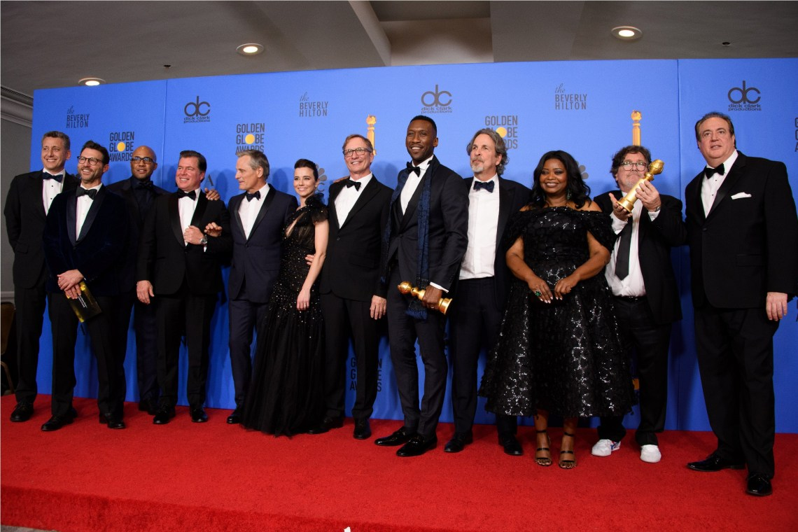 "After winning the Golden Globe for BEST MOTION PICTURE – COMEDY OR MUSICAL for ""Green Book"", John Sloss, Jonathan King, Kwame Parker, Brian Currie, Viggo Mortensen, Linda Cardellini, Jim Burke, Mahershala Ali, Peter Farrelly, Octavia Spencer, Charles B. Wessler, Nick Vallelonga pose with the award backstage in the press room at the 76th Annual Golden Globe Awards at the Beverly Hilton in Beverly Hills, CA on Sunday, January 6, 2019."
