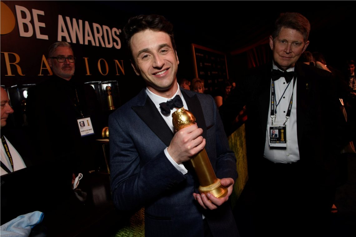 """After winning the category of BEST ORIGINAL SCORE – MOTION PICTURE for """"First Man,"""" Justin Hurwitz has his award engraved backstage at the 76th Annual Golden Globe Awards at the Beverly Hilton in Beverly Hills, CA on Sunday, January 6, 2019."""