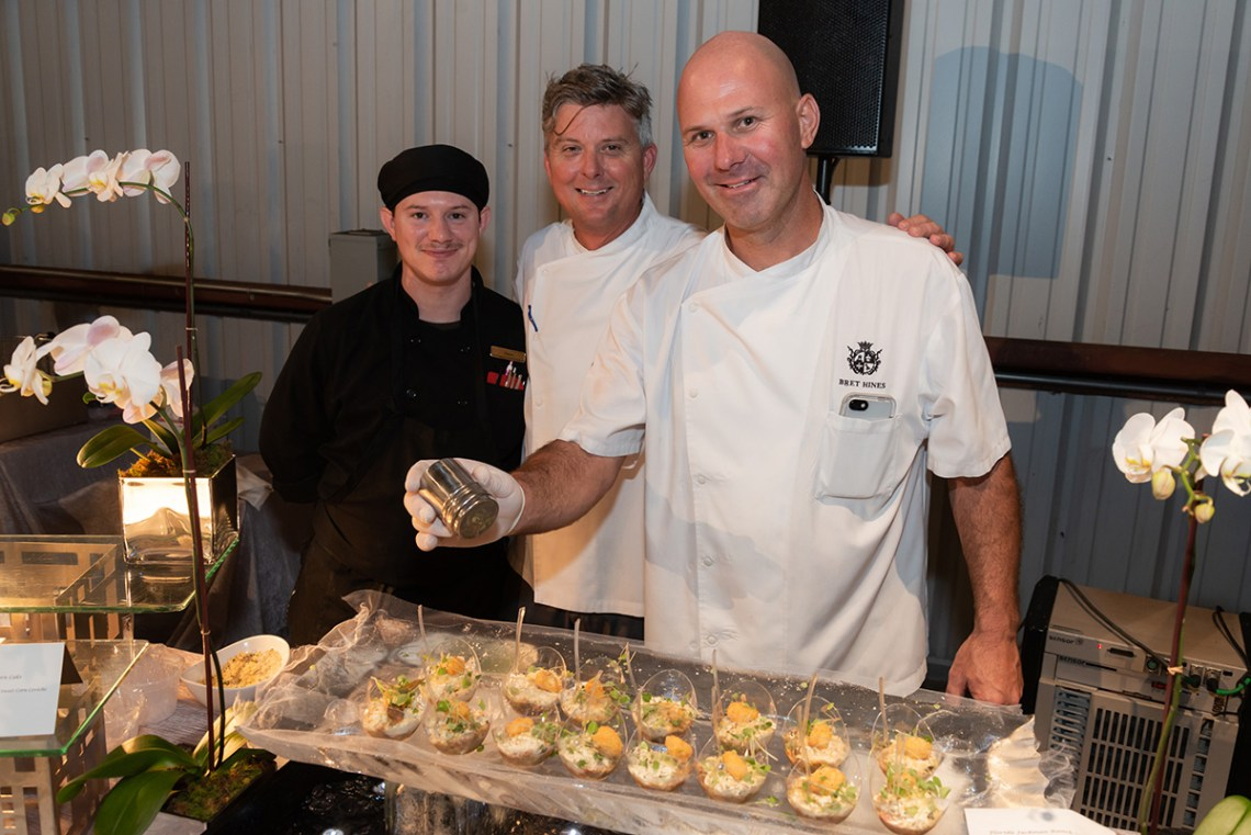 Boca Raton Resort Club serving gourmet delights at the duPont REGISTRY live Hangar Party