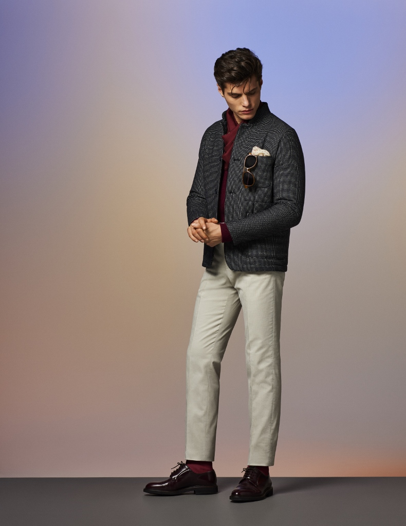 Black/White Large pindot wool padded shirt jacket over burgundy cardigan paired with jasmine white needlecord trousers, and finished off with cashmere and silk scarf, sunglasses, and burgundy calf derby shoes
