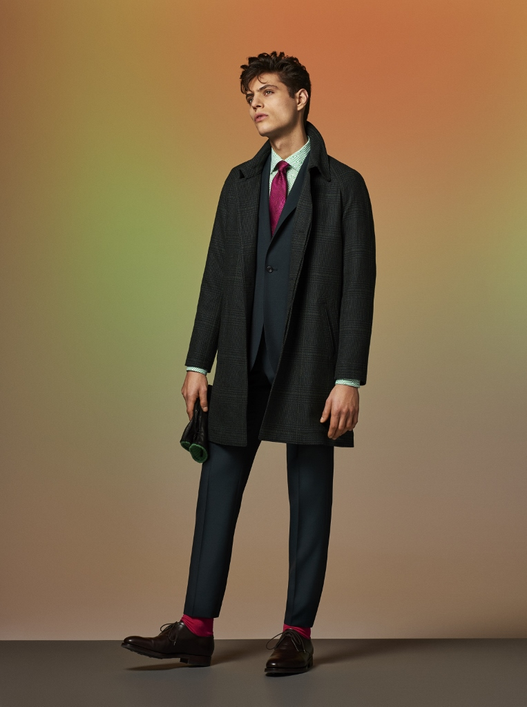 Prince of Wales wool rain coat over wool and mohair suit, pink oscillate silk tie, and finished off with black deerskin gloves and coffee burnished calf 2-eyed derby shoes