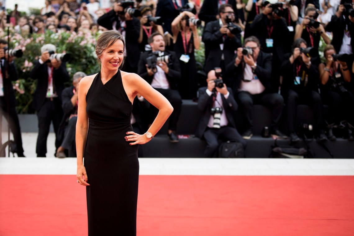 """VENICE, ITALY - AUGUST 28: CEO Jaeger-LeCoultre Catherine Renier wearing a Jaeger-LeCoultre watch walks the red carpet ahead of the Opening Ceremony and the """"La Vérité"""" (The Truth) screening during the 76th Venice Film Festival at Palazzo del Cinema on August 28, 2019 in Venice, Italy. (Photo by Tristan Fewings/Getty Images for Jaeger-LeCoultre)"""