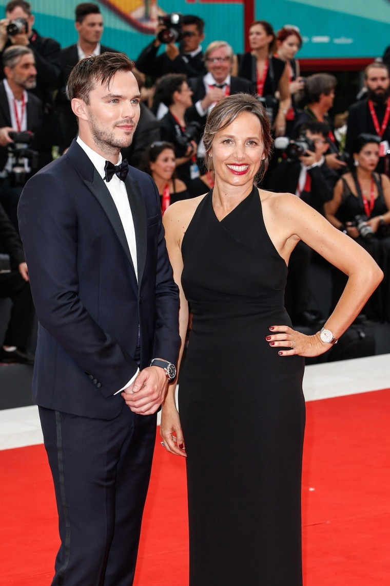"""Nicholas Hoult and Catherine Renier walk the red carpet ahead of the Opening Ceremony and the """"La Vérité"""" screening during the 76th Venice Film Festival at Sala Grande on August 28, 2019 in Venice, Italy. (Photo by Sebastiano Pessina for Jaeger-LeCoultre)"""