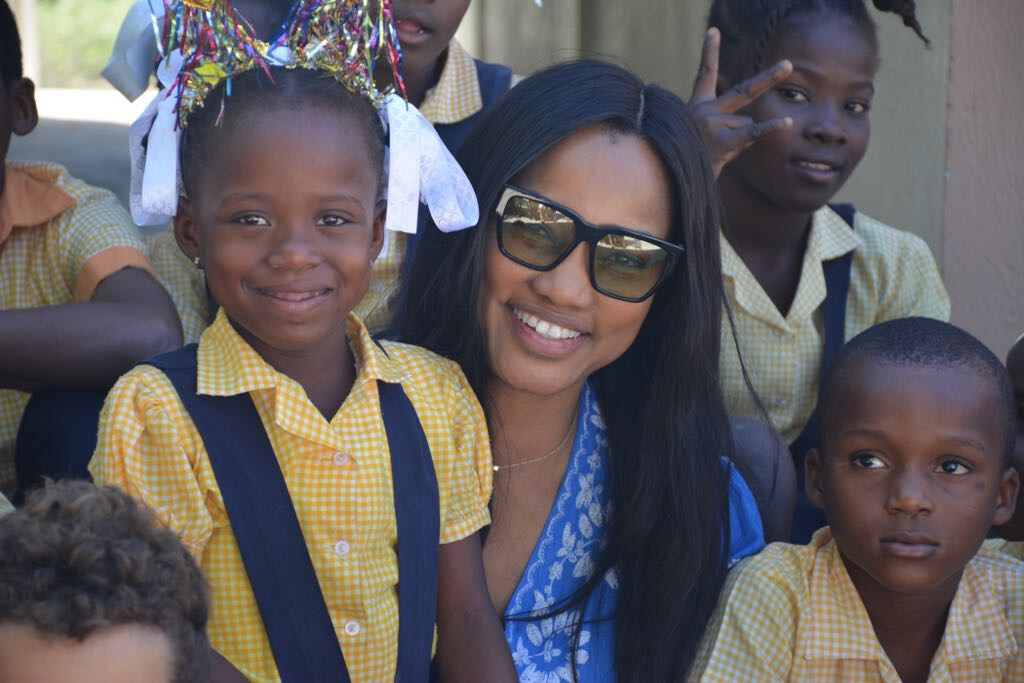 Actress Garcelle Beauvais with school children on mission to Haiti