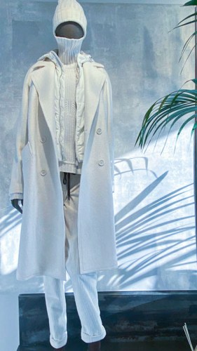 Layered clothes in white as it works best in Europe