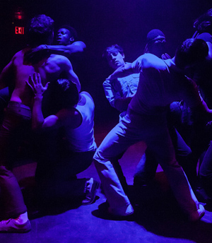 """Actors dance in the Stonewall In in the play """"Hit The Wall"""" by Ike Holter"""