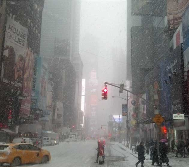 "Times Square, 2 p.m., January 21, 2014, snowing.  The first of the ""blizzards"" this year. Photograph by Jonathan Mandell."
